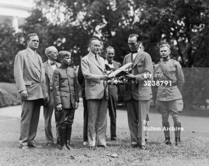 14th September 1925 Lt aviator Eddie Rickenbacker shows U.S. president Calvin Coolidge a model airplane on the grounds of the White House. Invited CC to New York Air Races.