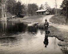 ca. 1922-1929, Simsbury, Connecticut, USA --- Original caption: Connecticut: President Calvin Coolidge fishing at the home of George McLean in Simsbury, Connecticut. --- Image by © Bettmann/CORBIS