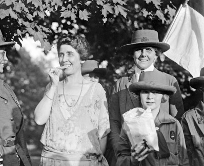 Mrs. Coolidge eating Girl Scout cookies 1923