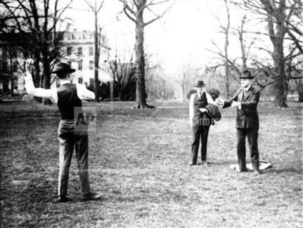 Coolidge playing with his boys, John & Cal Jr.Photo credit: AP.