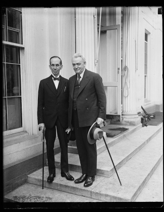 President Coolidge receives Massey and J. R. King, Director of Public Health Canada, at the White House, 1927. Photo credit: Library of Congress.