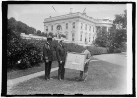 Along with those who also submitted their work for the 1928 International Sports in Art Exhibition in Amsterdam was Hayley Lever, Australian-born but representing the United States. Here he is presenting a painting of the yacht Mayflower to President Coolidge and Captain Andrews at the White House, 1925.