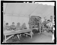 Soldiers visiting a YMCA library tent.